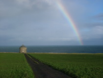 Rainbow over Mussenden - www.countrybagging.com